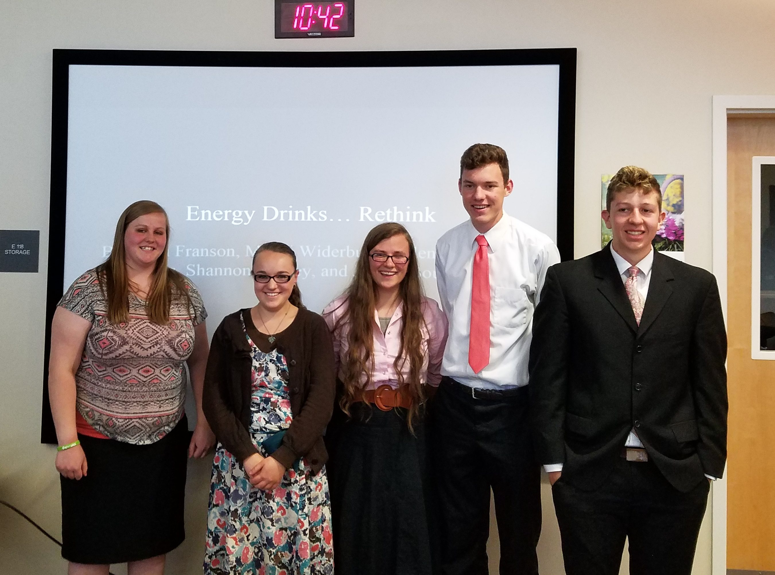 Mandi Widerburg, Valentine  PasseCarlus, Shannon Wilkey, and Joshua Burgeous after presenting their project citizen on Energy Drinks and answering questions