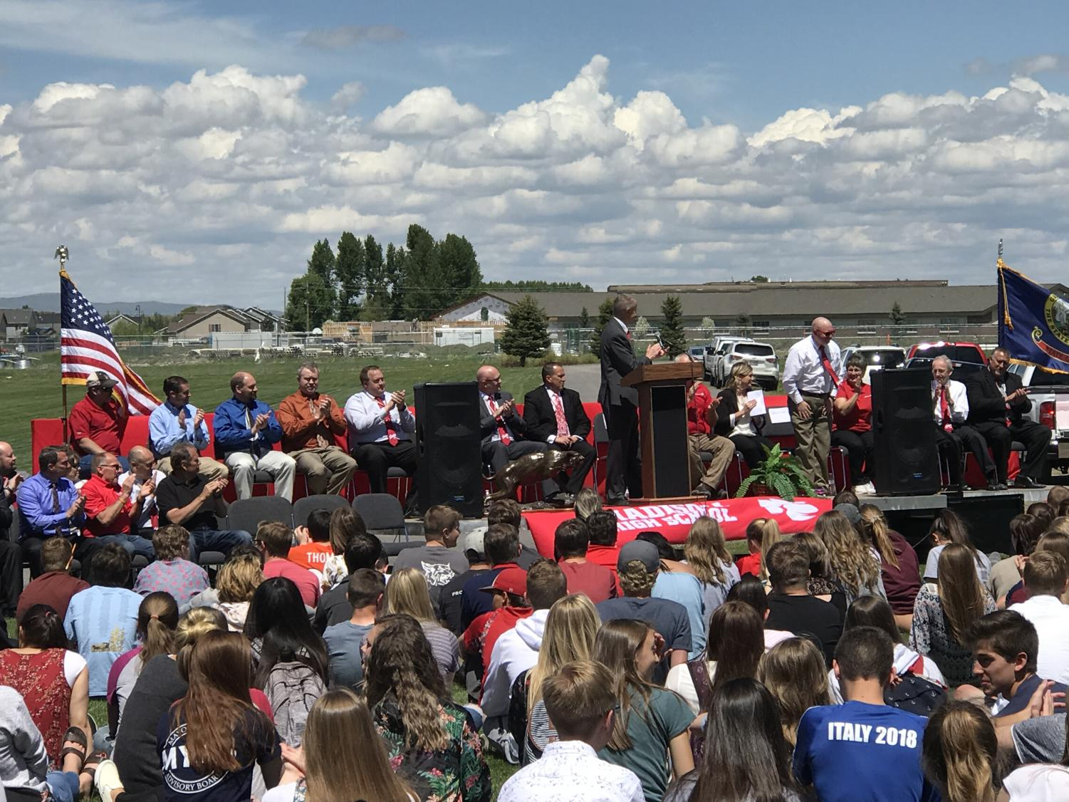 Students listen to Sr. Thomas as he intorduces the School board members at the Groundbreaking Ceremony.
