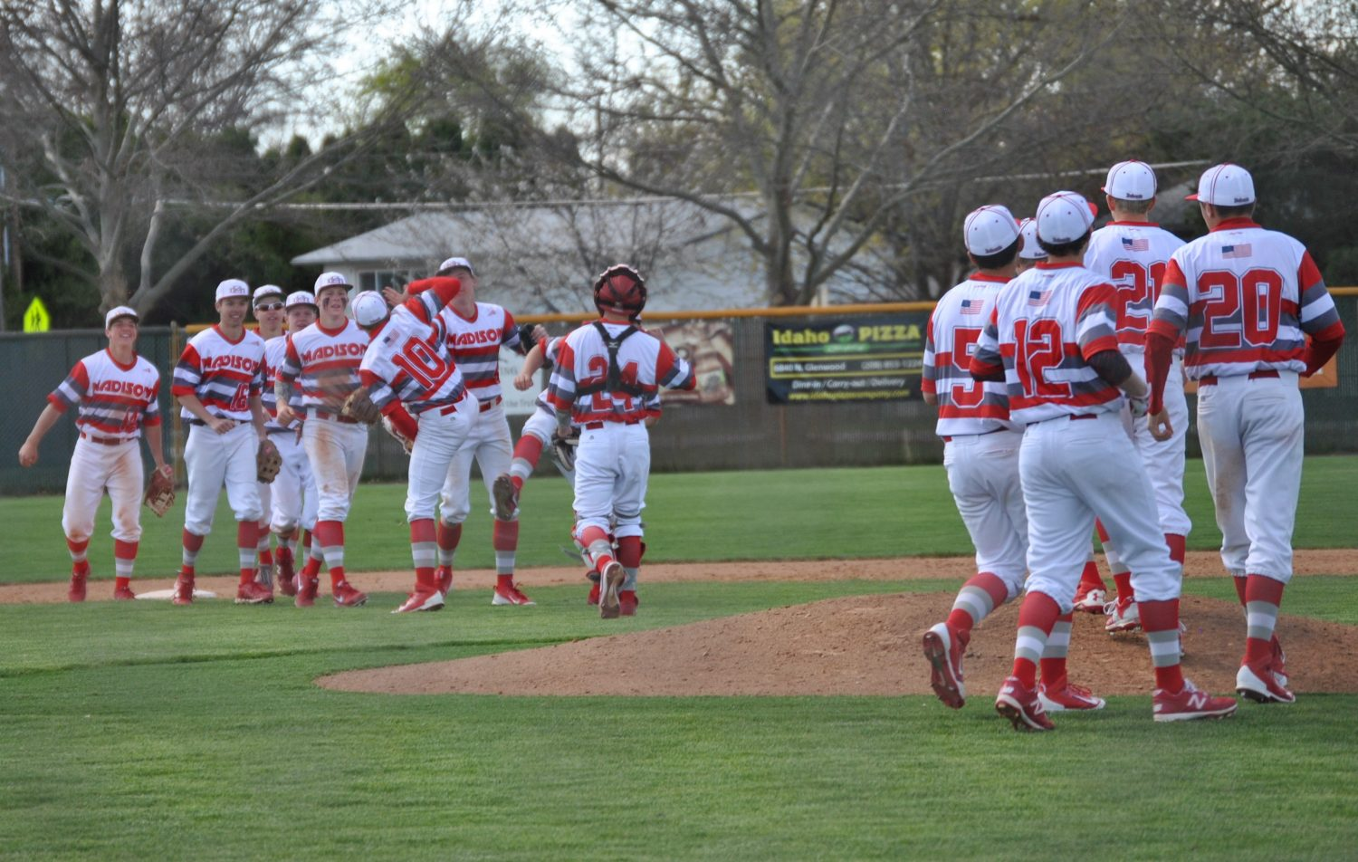 Madison%E2%80%99s+varsity+team+celebrating+in+style+after+Matt+Bolingbroke+threw+a+complete+game+against+Capital+in+Boise.+Courtesy+photo%3A+Ginger+Crawford%0A