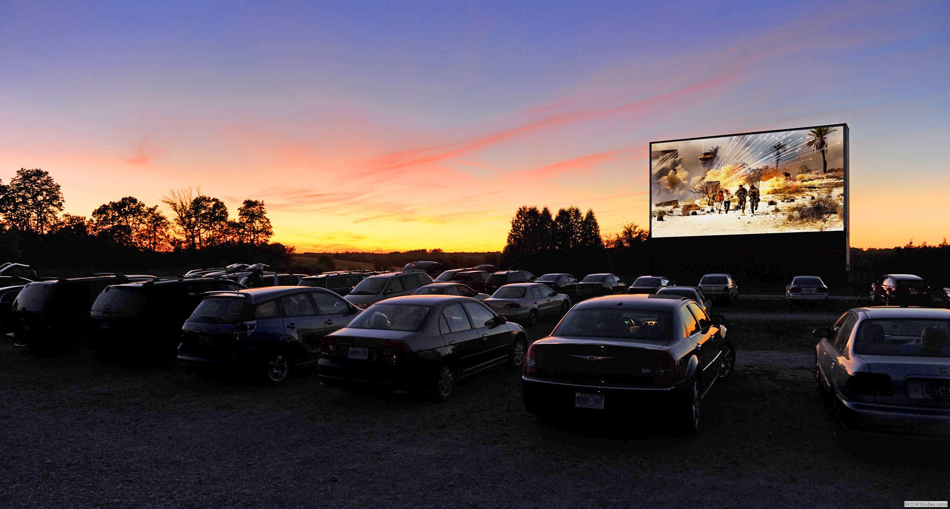 Cutline- People enjoying a nice movie at the Drive In. Credit: google