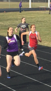 Brooke Hammond battling to take first place on the 200 meter dash. photocredit: brielle Hammond