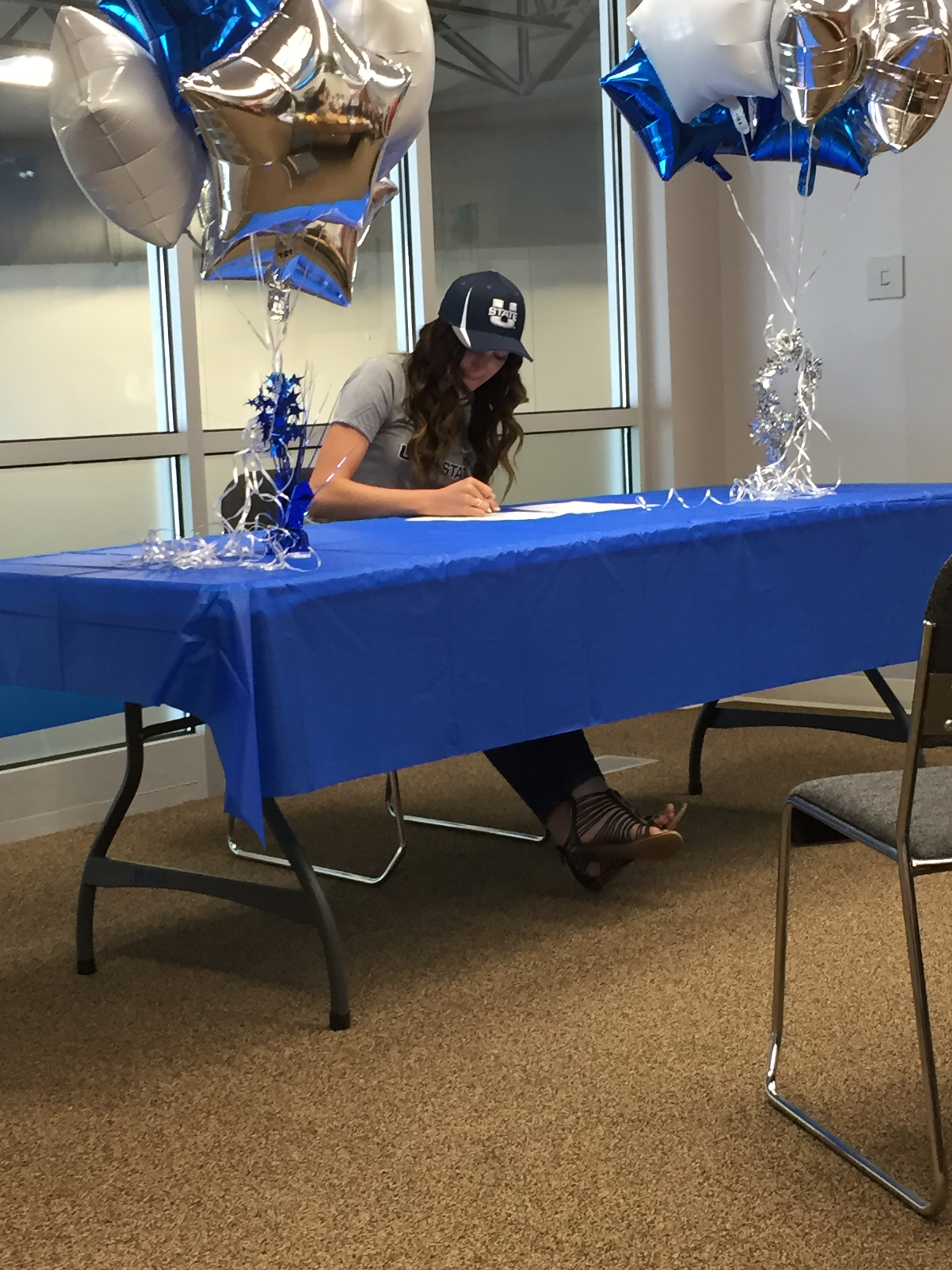 Remi McWhorter signing to run track with Utah State University.