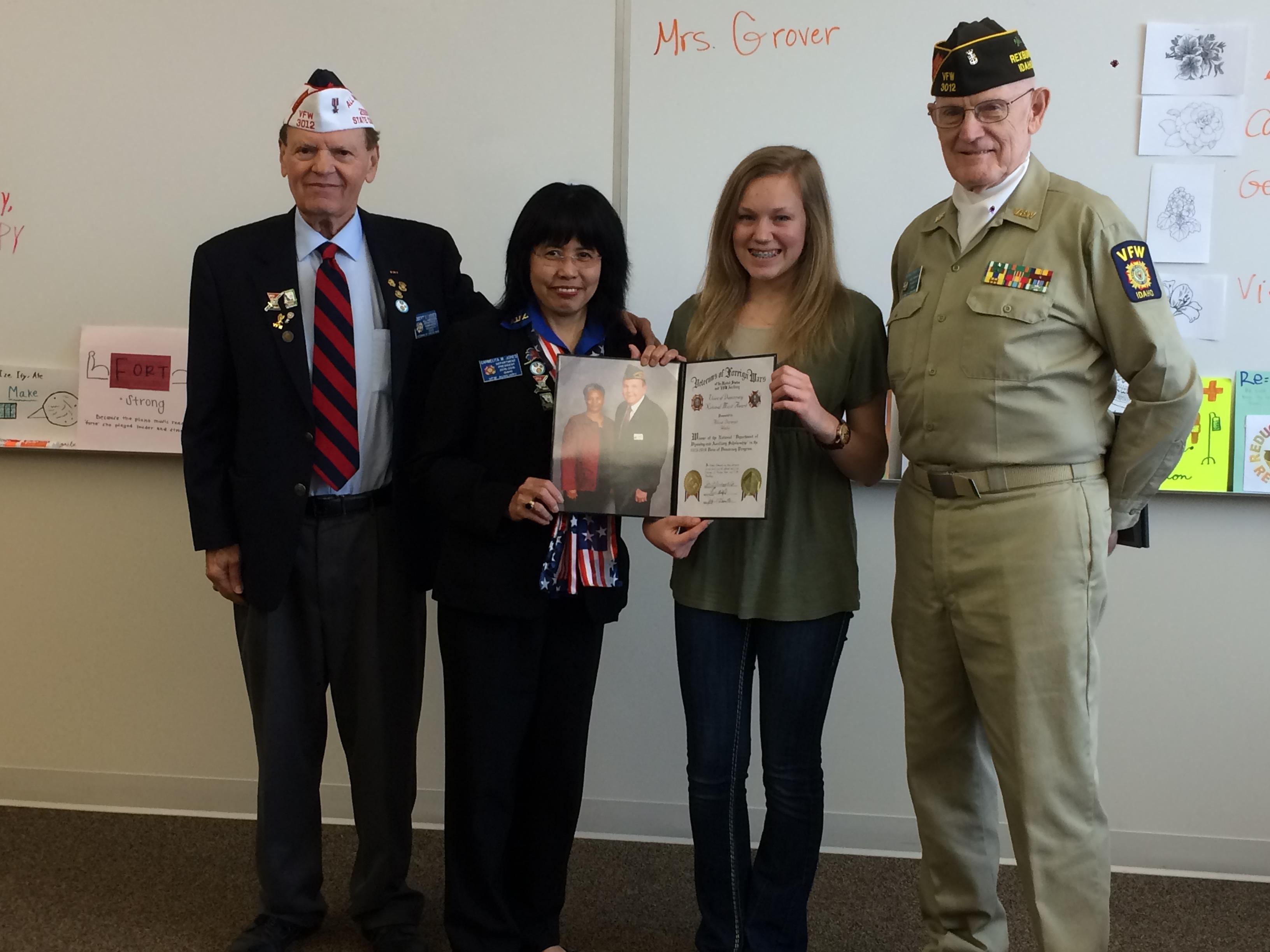 Robert Jones, Carmelita Jones, and Richard Pingry from the Idaho Veterans of Foreign Wars presents an award to sophomore Alissa Dorman.