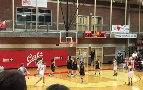 Lady Bobcats hold off the Trojans