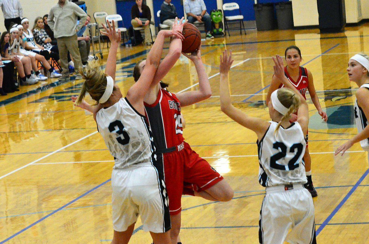 Bethany Dow shoots over Skyline player