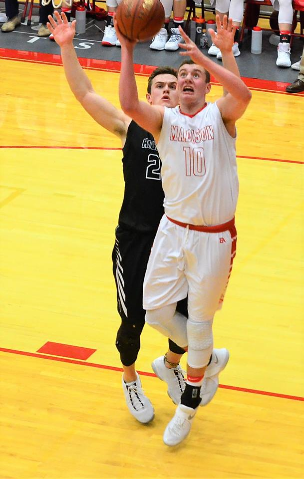 Joe Dougherty drives for a basket during Madison' s  73-56 win over Highland.