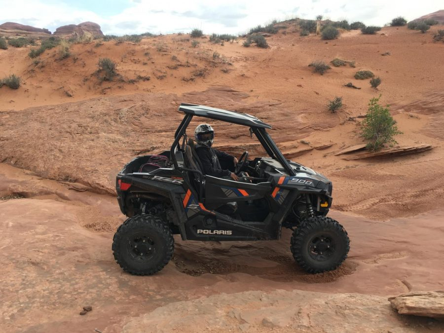 Senior, Reggie South razor riding in Moab, Utah. His family went there for spring break. The South family does this every year for their spring break.