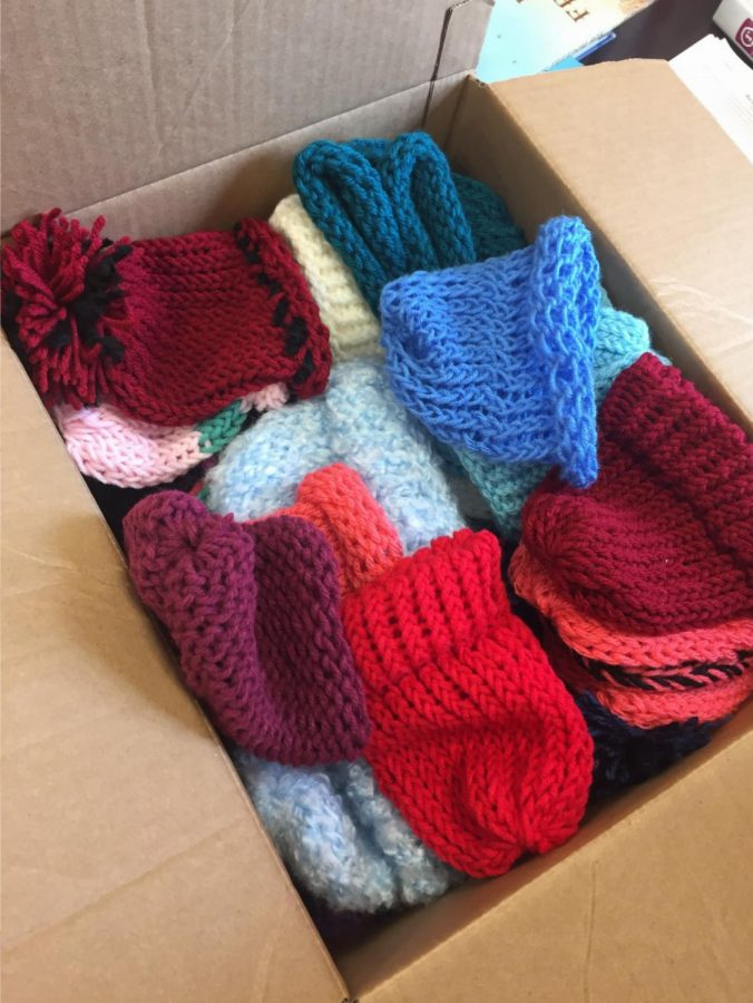 A box of collected beanies that the Key Club made. So far they have made 51.
