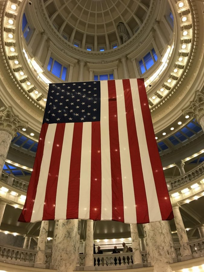 An exchange student captures a picture of the American flag in Idaho's State Capital Building in Boise.