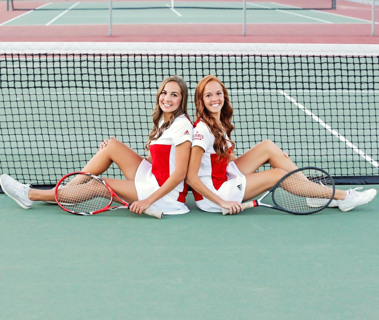 Seniors Brooke and Brielle Hammond pose for pictures on our home courts at MJH.