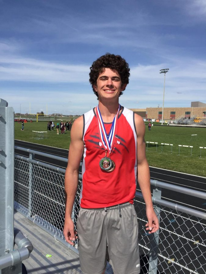 Senior Jeremy Jacobson poses with medals won at one of last season's track meets.