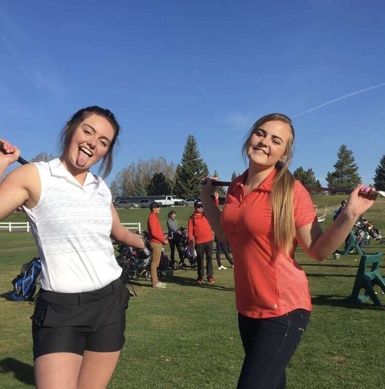 Junior+Sophie+Jeppesen+and+Junior+Katelyn+Ricks+pose+as+they+get+ready+for+their+tournament+at+Teton+Lakes.+They+played+in+the+same+group.+Ricks+shot+a+104+and+Jeppesen+shot+a+105.+%0A