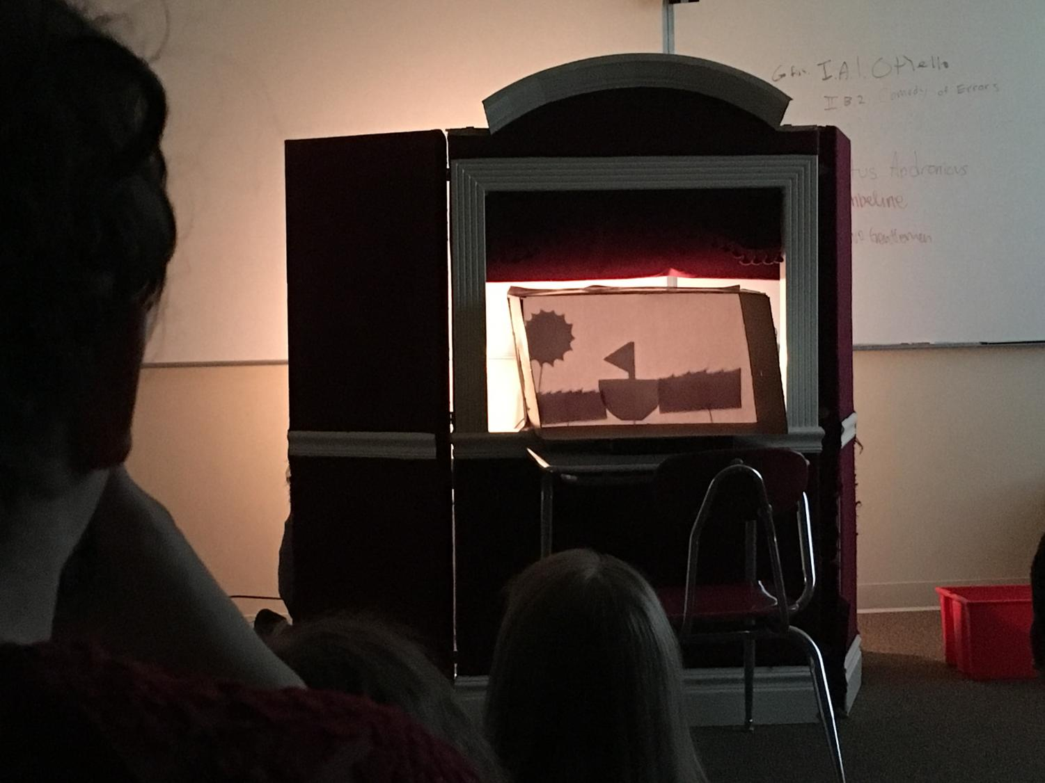"A group performs their rendition of Shakespeare's ""Comedy of Errors"" in the form of shadow puppets."
