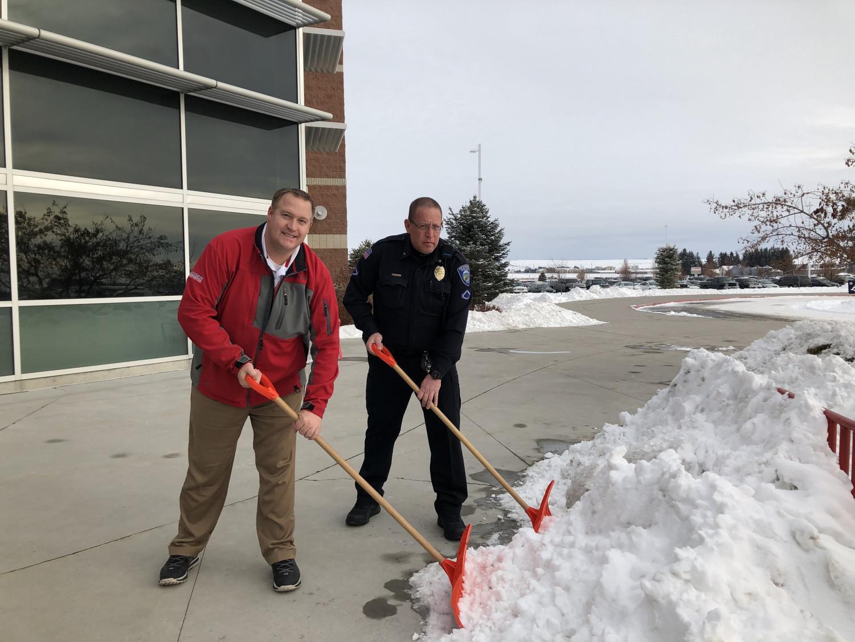 Mr. Klassen and Bovie keeping the sidewalks clear of snow