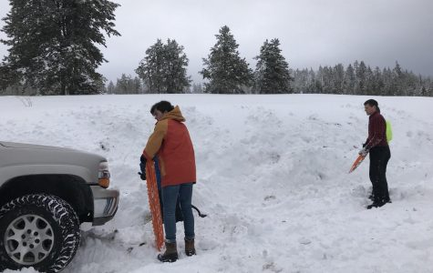 The Student Council works on getting their car unstuck. Photo Credit: Ambree Christensen.