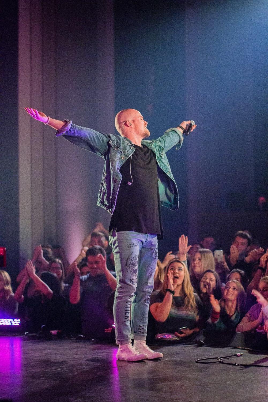 Lead singer EJ Michels enjoying the energy of the crowd. photo credit: Samantha Vanderwalker.