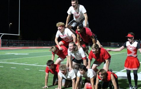 The boys do a pyramid for the half time show.