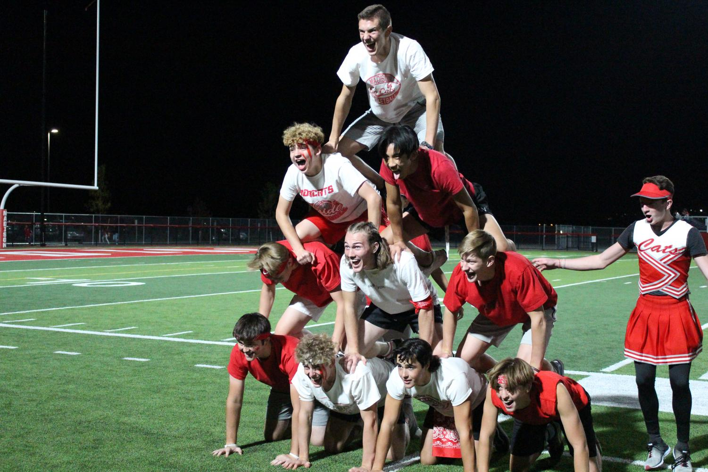 The boys do a pyramid for the half time show.