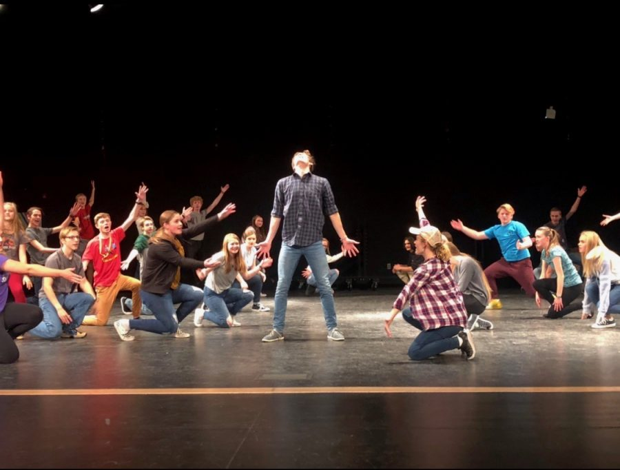CJ Rawlings center stage during the scene Broadway Rhythm at the beginning of act 2.