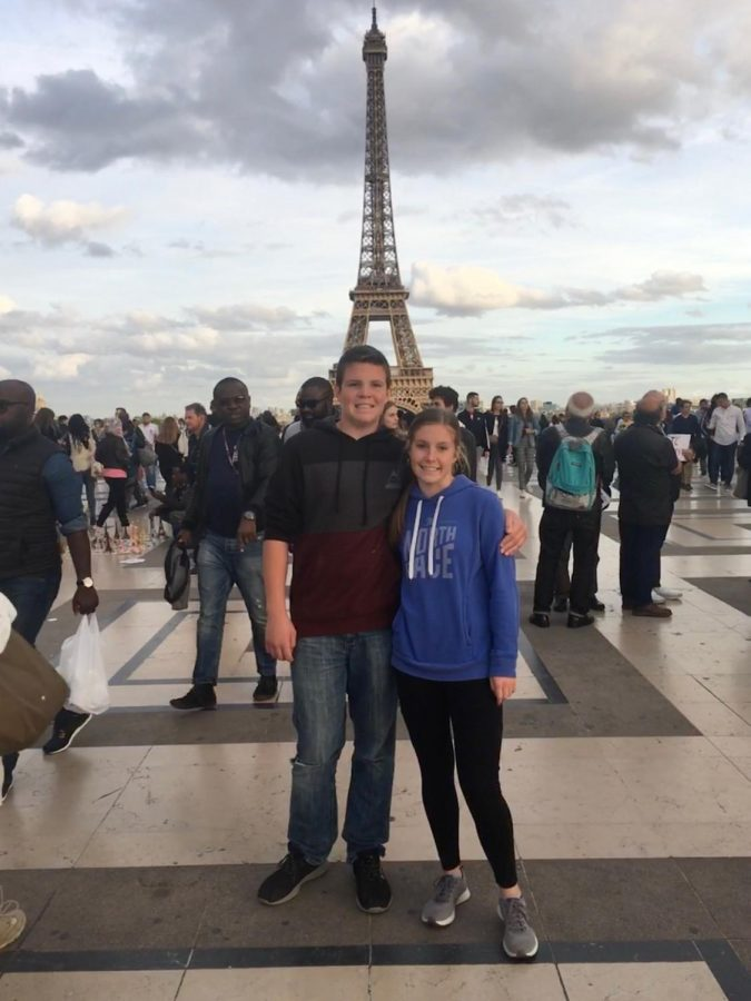 Hailey and Brock Mortensen in front of the Eiffel Tower.
