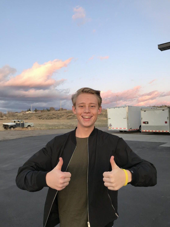 Senior Mason Olsen poses in front of the sunset.