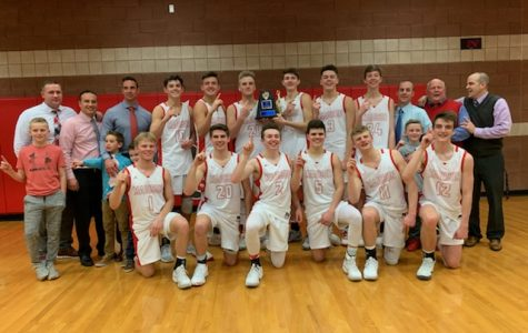 Last years varsity basketball team after winning the district title.
