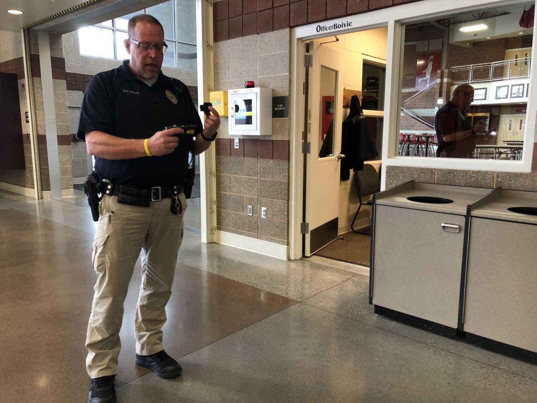 Officer Boivie shows his taser