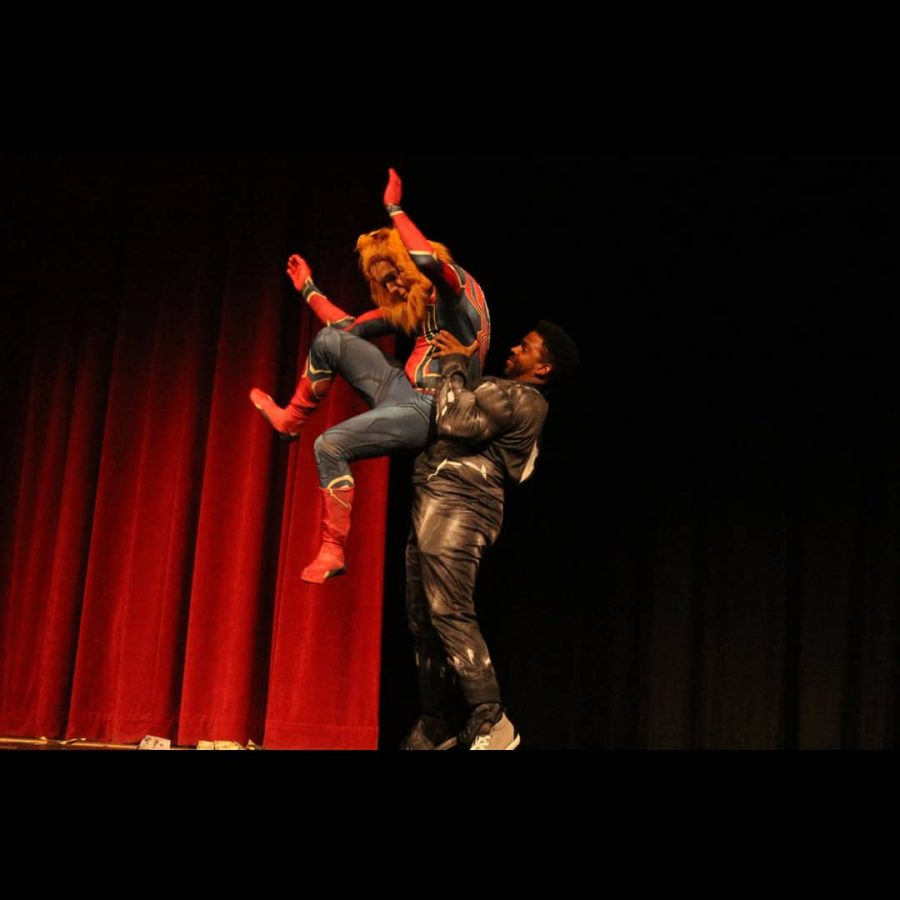 Stephen Meek is tossed in the air by Stacey Harkey during the last act of the night.