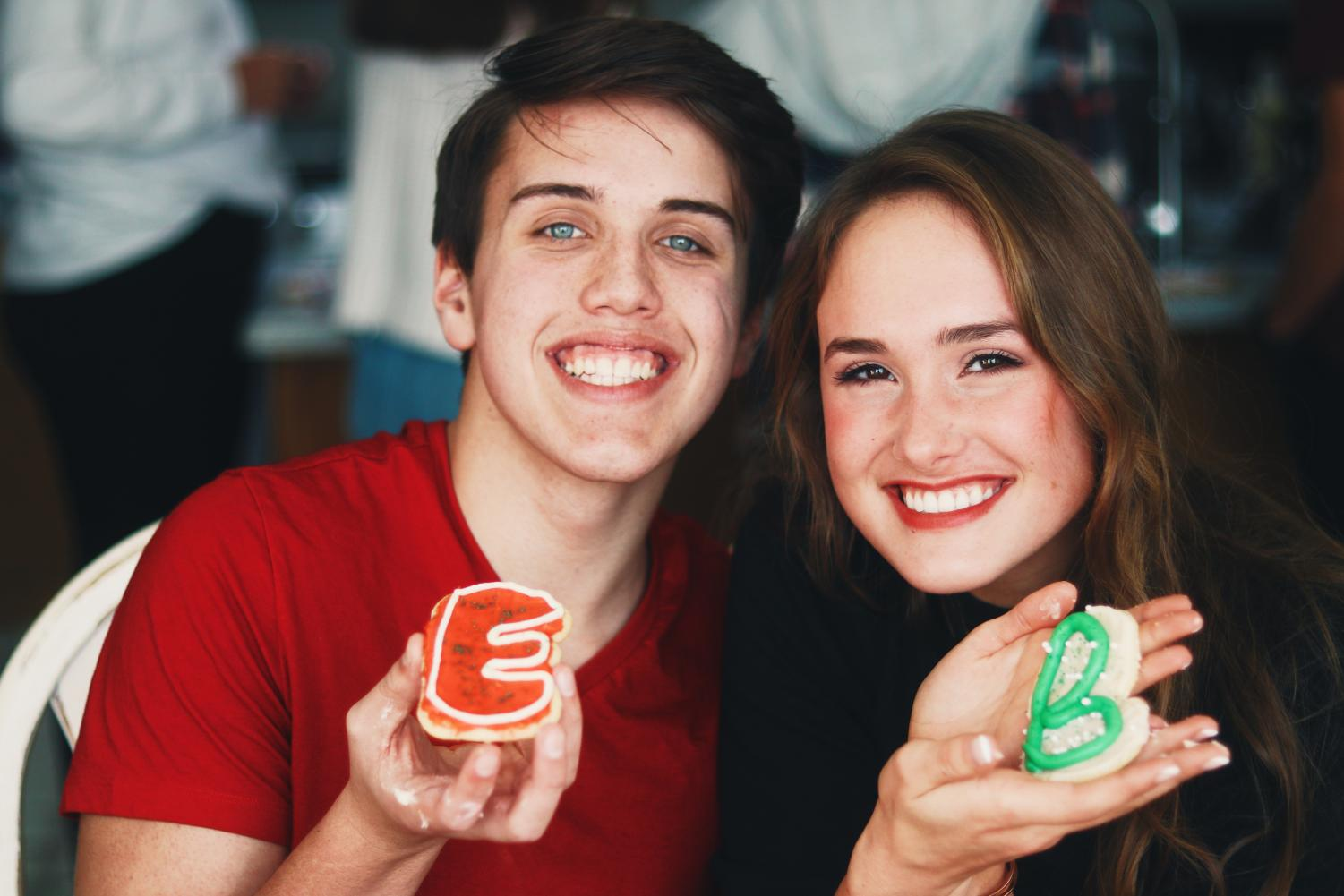 Benson Gugelman and Ellie Wolfe decorating Christmas cookies on their day date.