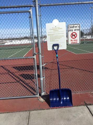Shovels are seen at the tennis courts.