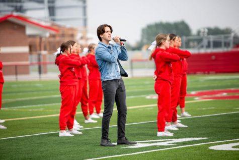 Benson singing the national anthem.