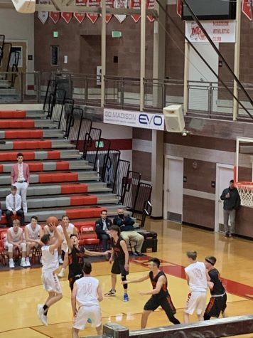 Chase Crane pulls for a deep 2-pointer in the Madison JV win over Idaho Falls