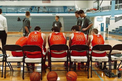 The boys basketball team planning out there next play