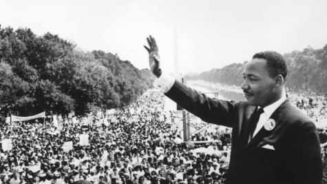 Martin Luther King Jr. waving to the crowd