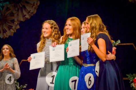 Emily Dustin, Clara Thomas, Mikelle Dorman, Andrea Erikson, photographed holding their awards