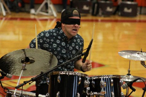 In the fist day of school assembly Clint Pulver playing the drums blindfolded.