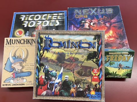 Some of Mr. Fillmore's board games. Most people love Dominion.