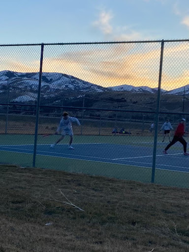 Lundin playing tennis at Central High School.