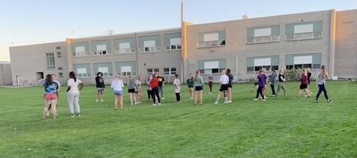 MHS Senior powderpuff team practicing before the big game.