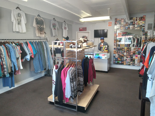 The view when first entering the store, showing the merch and featuring Ethan Lazanos, co-owner of the store.