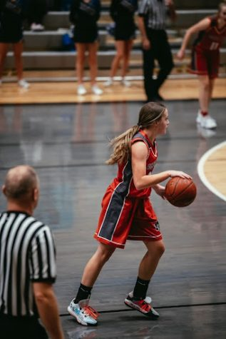Mackenzie dribbling the ball down the court in one of their games.