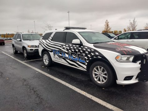 One of the Rexburg Police cars in the parking lot at MHS. Snow will be getting stuck on the windshields soon.